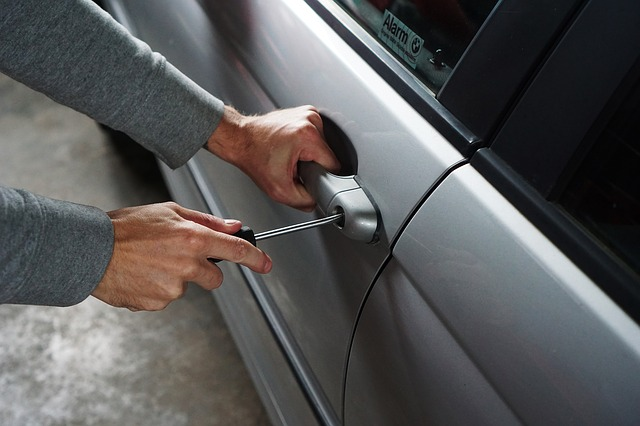 Stock image of someone breaking into a car